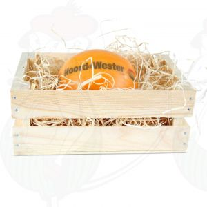 Edam cheese in a wooden crate